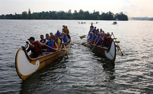 Métis Canoes on water