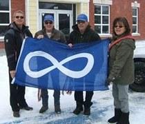 People holding Metis flag
